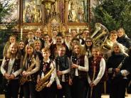 Neujahrskonzert: Bläser und Sänger in St. Leonhard