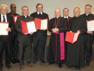 : Bischof ehrt Dekan Stefan Gast und Hans Schweizer