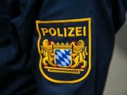 Holzheim: Mädchen beißt Polizeibeamten