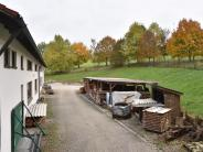 Kommunalpolitik: Rutschiger Hang und umstrittenes Haus