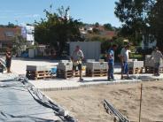 Umbau: Am neuen Dorfplatz wird gepflastert