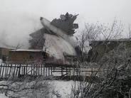 Flugzeug-Absturz: Flugzeug stürzt über kirgisischem Dorf ab