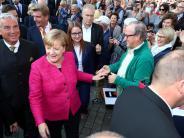 Ulm: Wahlkampfauftritt in Ulm: Beifall und Pfiffe für Angela Merkel