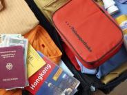 Reisen: Liste führen und Kleidung rollen: Tipps zum Kofferpacken