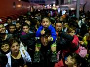 Flüchtlinge: De Maizière: 2015 kamen 890.000 Flüchtlinge statt 1,1 Millionen