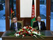 International: De Maizière: Afghanen sollen in ihrer Heimat bleiben