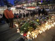 Debatte über Abschiebepraxis: Schweden gedenkt Anschlagsopfern