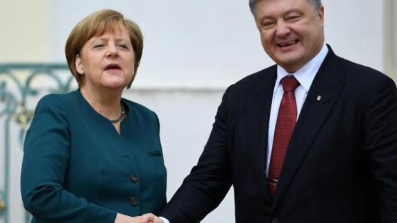 Merkel stellt Ukraine neue Gespräche über Friedenslösung in Aussicht
