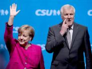 Wahlkampfabschluss: Merkel und Seehofer demonstrieren in München Einigkeit