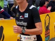 Triathlon: Eine Kuhglocke als Pokal