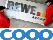 Neuer Rechtsstreit: Übernahme von Coop-Märkten: Edeka geht gegen Rewe-Pläne vor